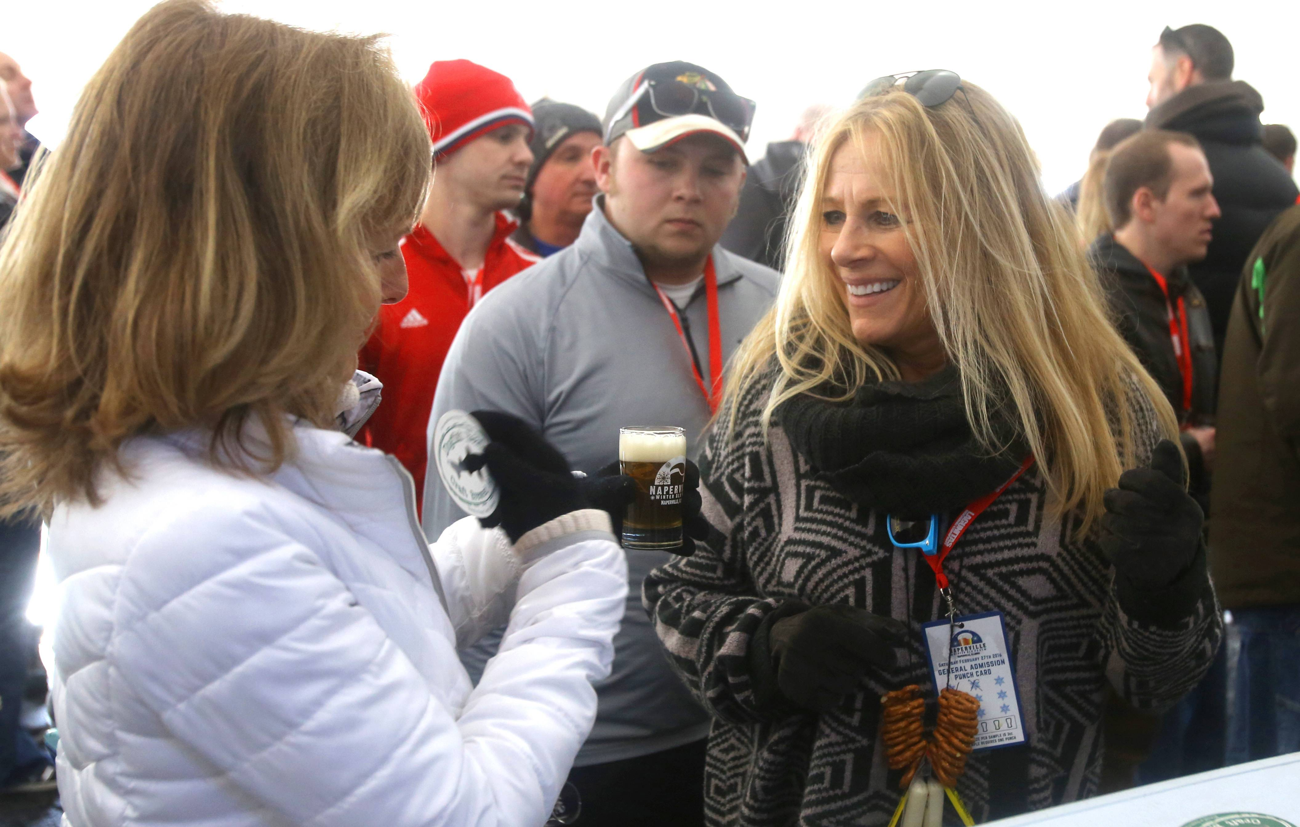 Judy Schaller, left, and Kathy Fritz, right, both of Naperville, wait in line for a craft beer during the third annual Naperville Winter Ale Fest at Frontier Park.