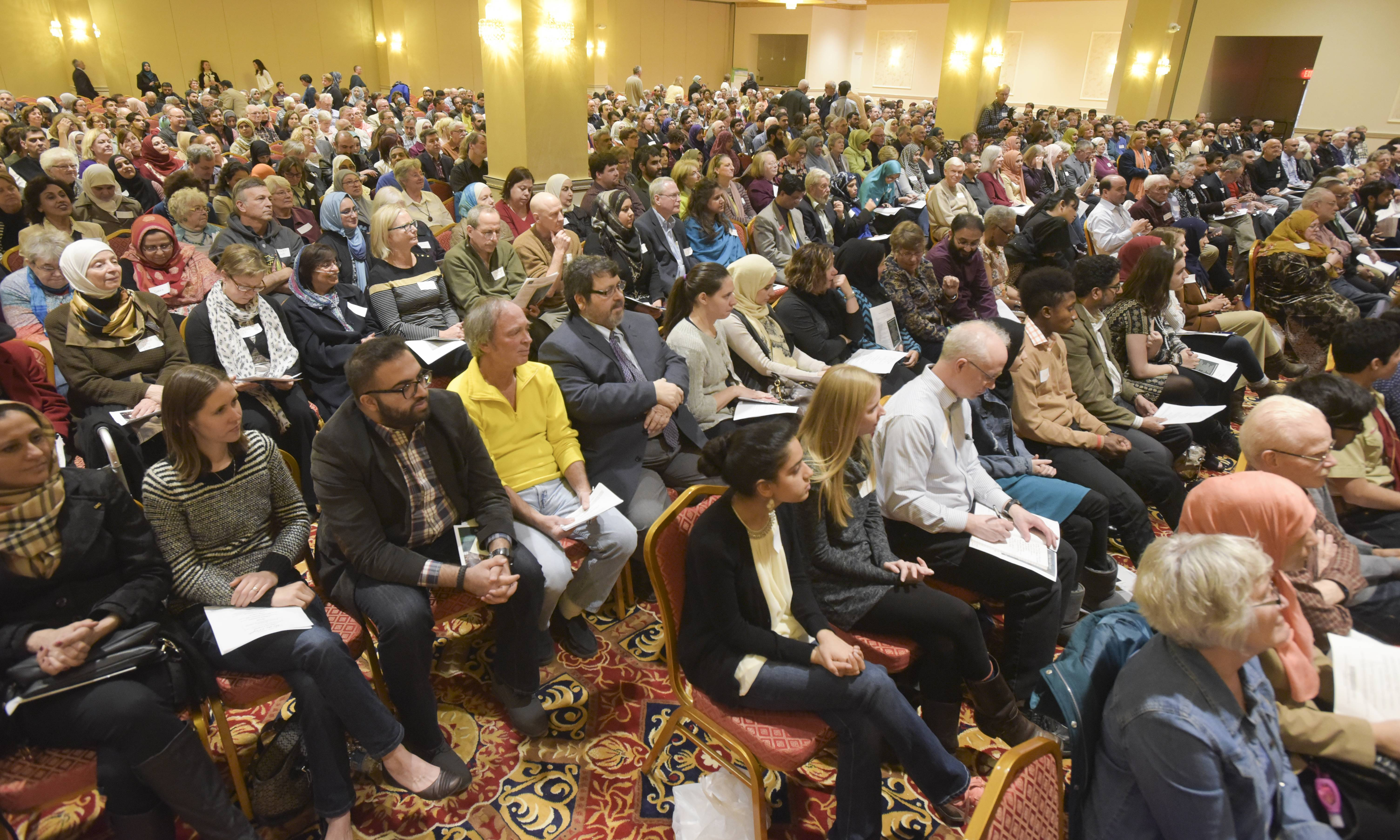 "Hundreds filled an Addison banquet hall Sunday to express religious solidarity during the DuPage United's ""We the People"" event. ""?Clearly, we are acting as a part of something powerful,"" attendee Meredith Muir said."