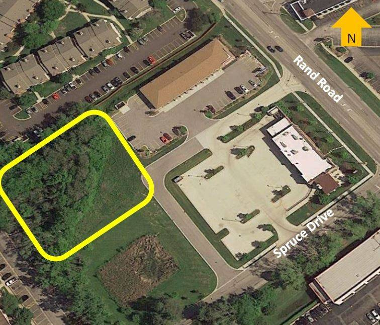 A bird's-eye view of the acre of village-owned land behind the Firestone Complete Auto Care at 1980 N. Rand Road on which Up Development is proposing a three-story, 44-unit apartment building for people with disabilities.