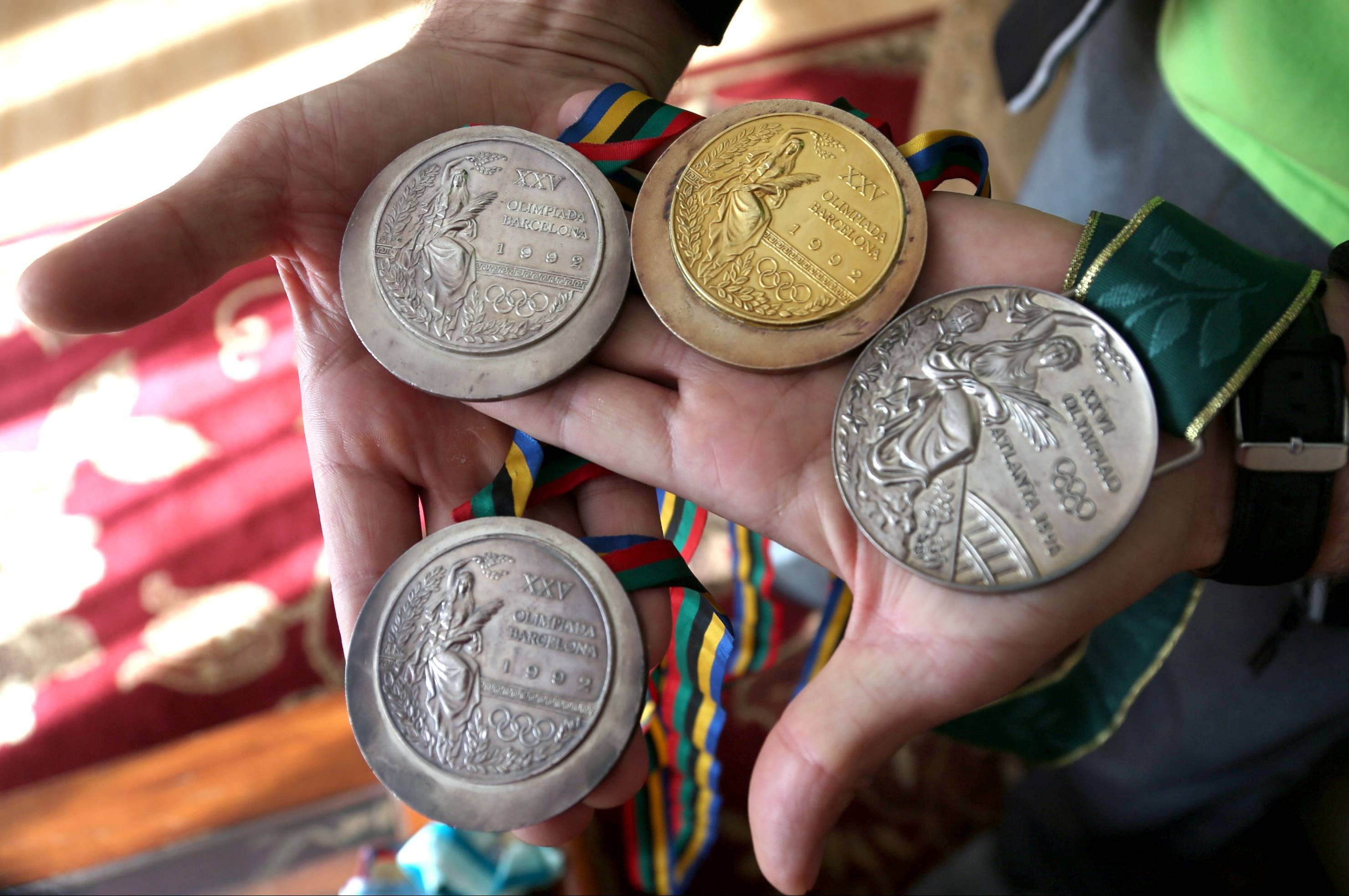 "Vladimir ""Vlad"" Pyshnenko holds his Olympic medals. Two silver and a gold from the 1992 games in Barcelona, Spain, and a silver from the 1996 games in Atlanta."