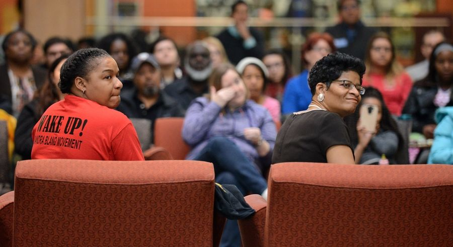 "Sandra Bland's sister and mother, Shavon Bland, left, and Geneva Reed-Veal, watch a video presentation about Bland Monday during Elgin Community College's ""Real Talk"" panel discussion on race relations."