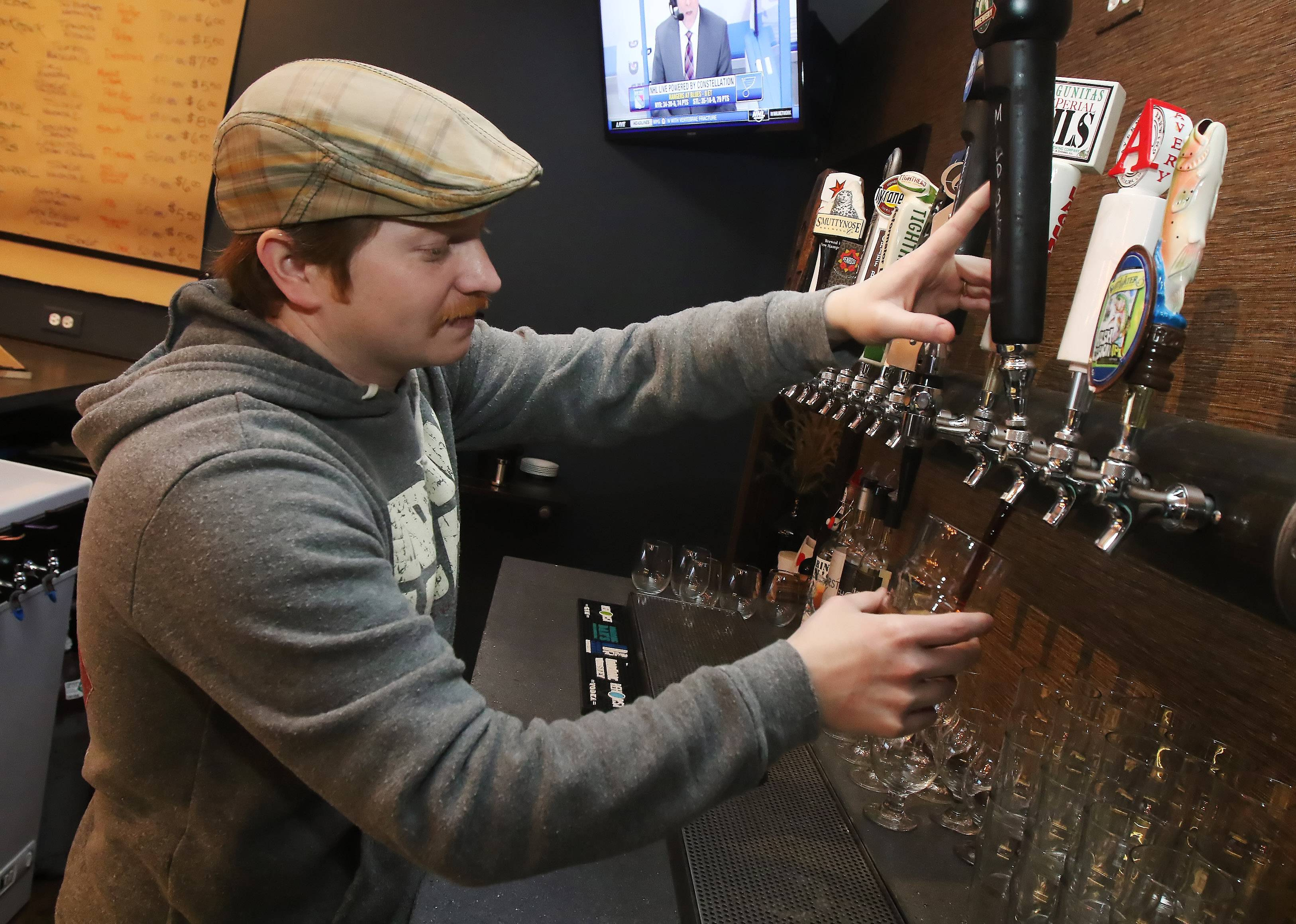 Jason Vucic pours a beer at Side Lot Brewery in Wauconda.