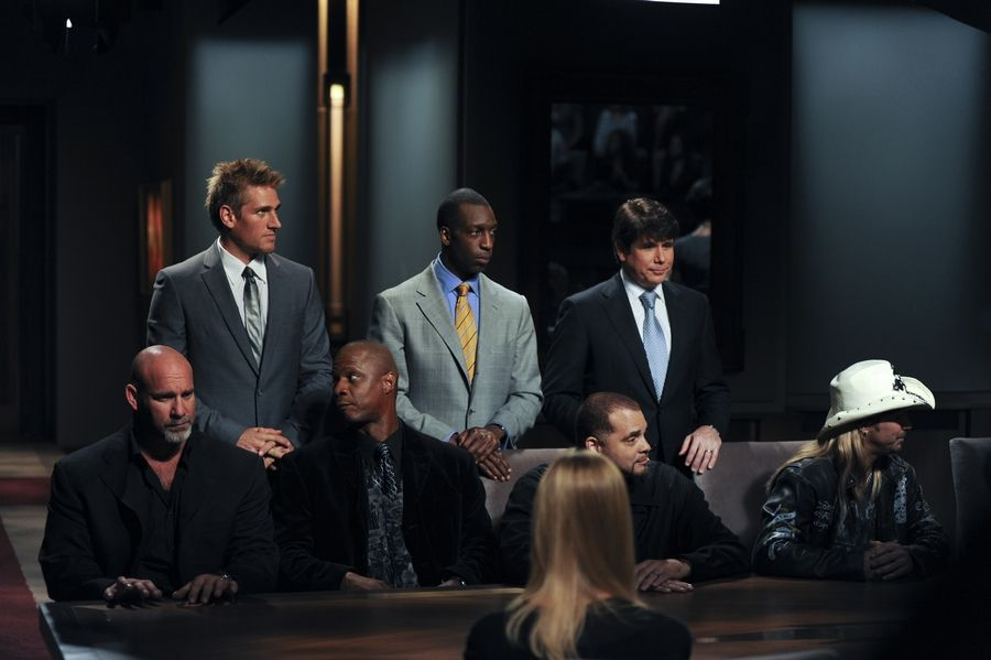 "Rod Blagojevich stands with his team on ""Celebrity Apprentice."""