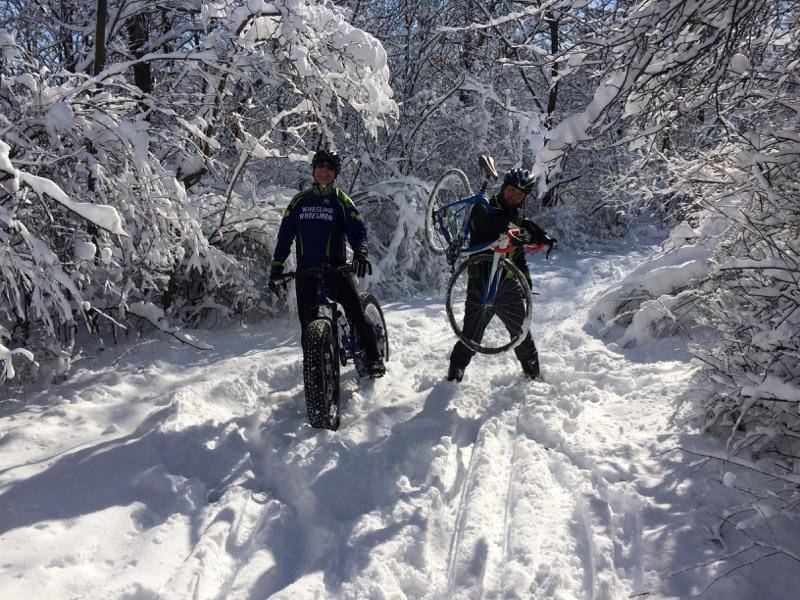 Hiroshi Watanabe, right, of Vernon Hills enjoy his first snow in Chicagoland after moving from Japan by biking with Mitch Rosset of Des Plaines at Deer Grove Forest Preserve Trail on November 22.
