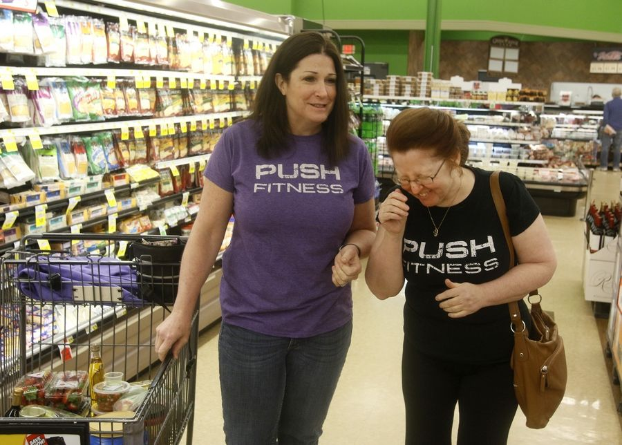 Janet Ford, left, and Annie Overboe, right, joke around while shopping for healthier foods at Valli Produce in Glendale Heights.