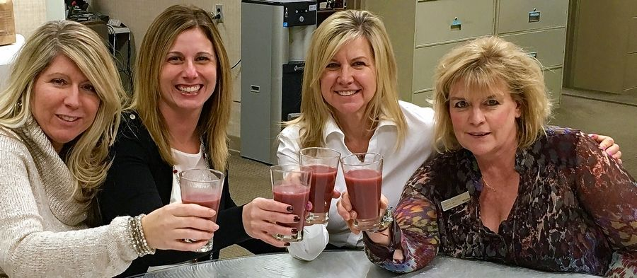 Members of the Westin Refreshers Fittest Loser at Work team sip healthy smoothies. Replacing bananas and pineapple with blueberries can give your morning smoothie an extra nutritional punch without as much sugar.
