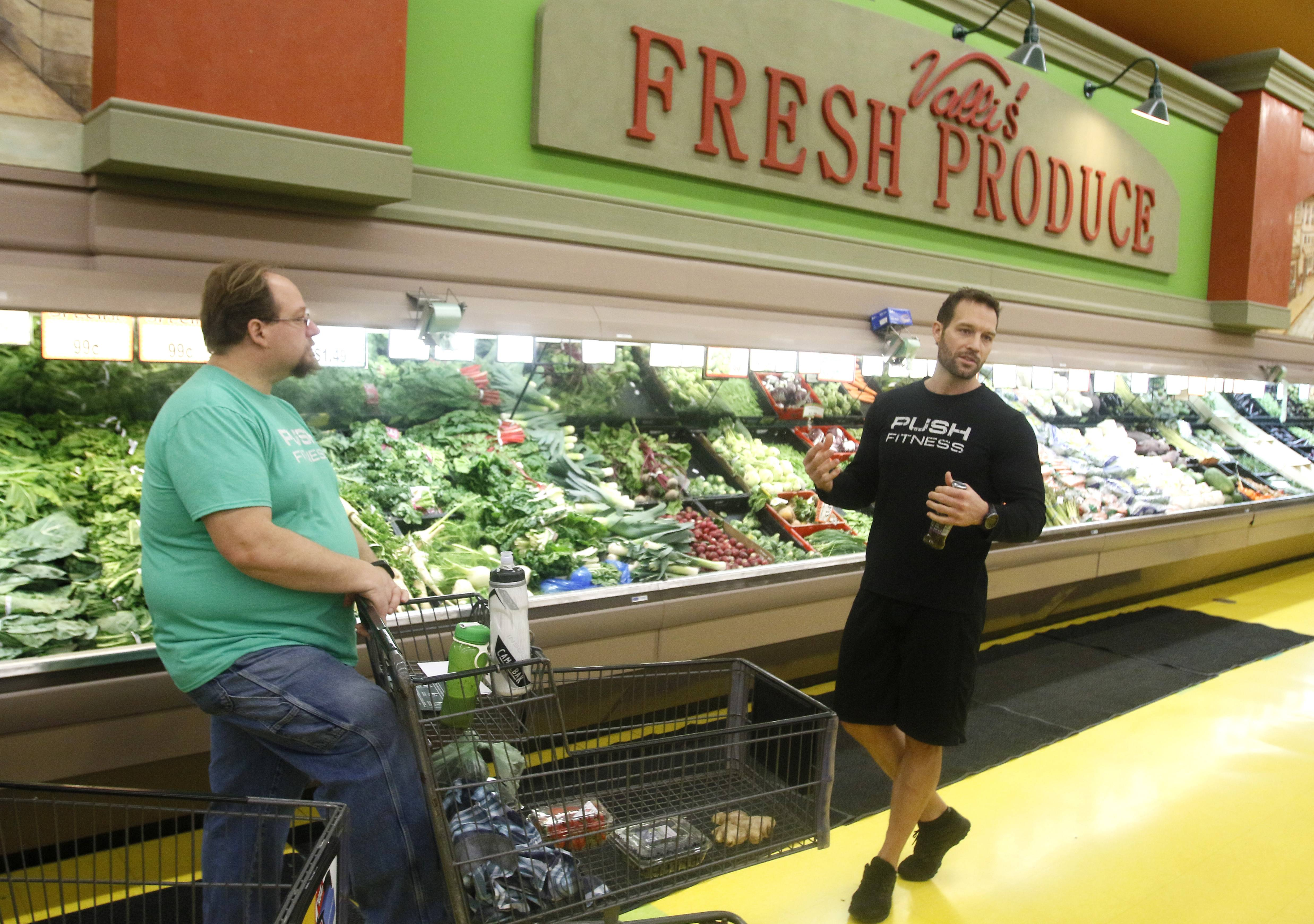 Mel Boldt and the other Fittest Loser contestants learn how to shop for healthier food with their Push Fitness trainer Josh Steckler at Valli Produce in Glendale Heights.