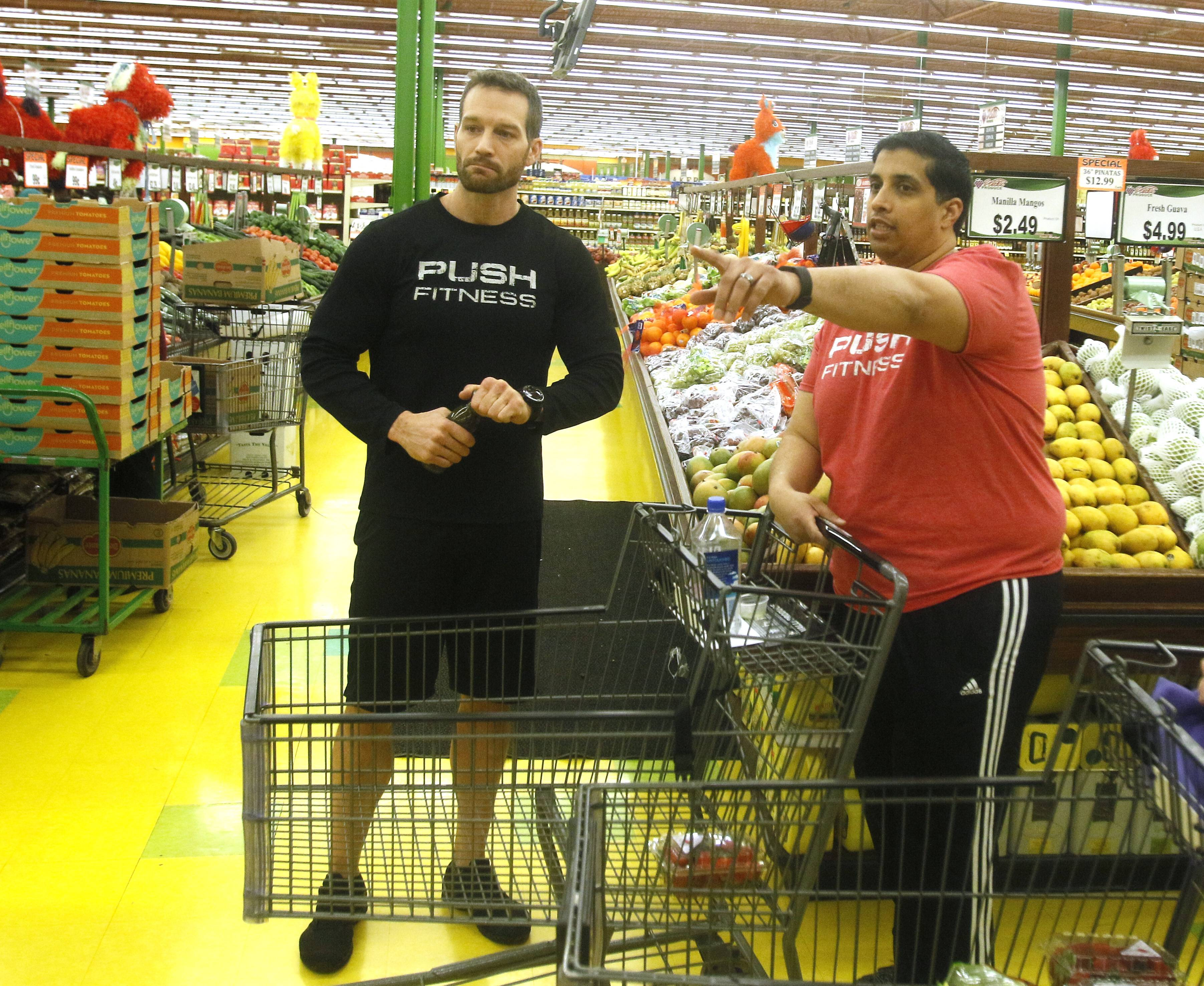 Jiten Patell and the Fittest Loser contestants, learn how to shop for healthier food with their Push Fitness trainer Josh Steckler at Valli Produce in Glendale Heights.