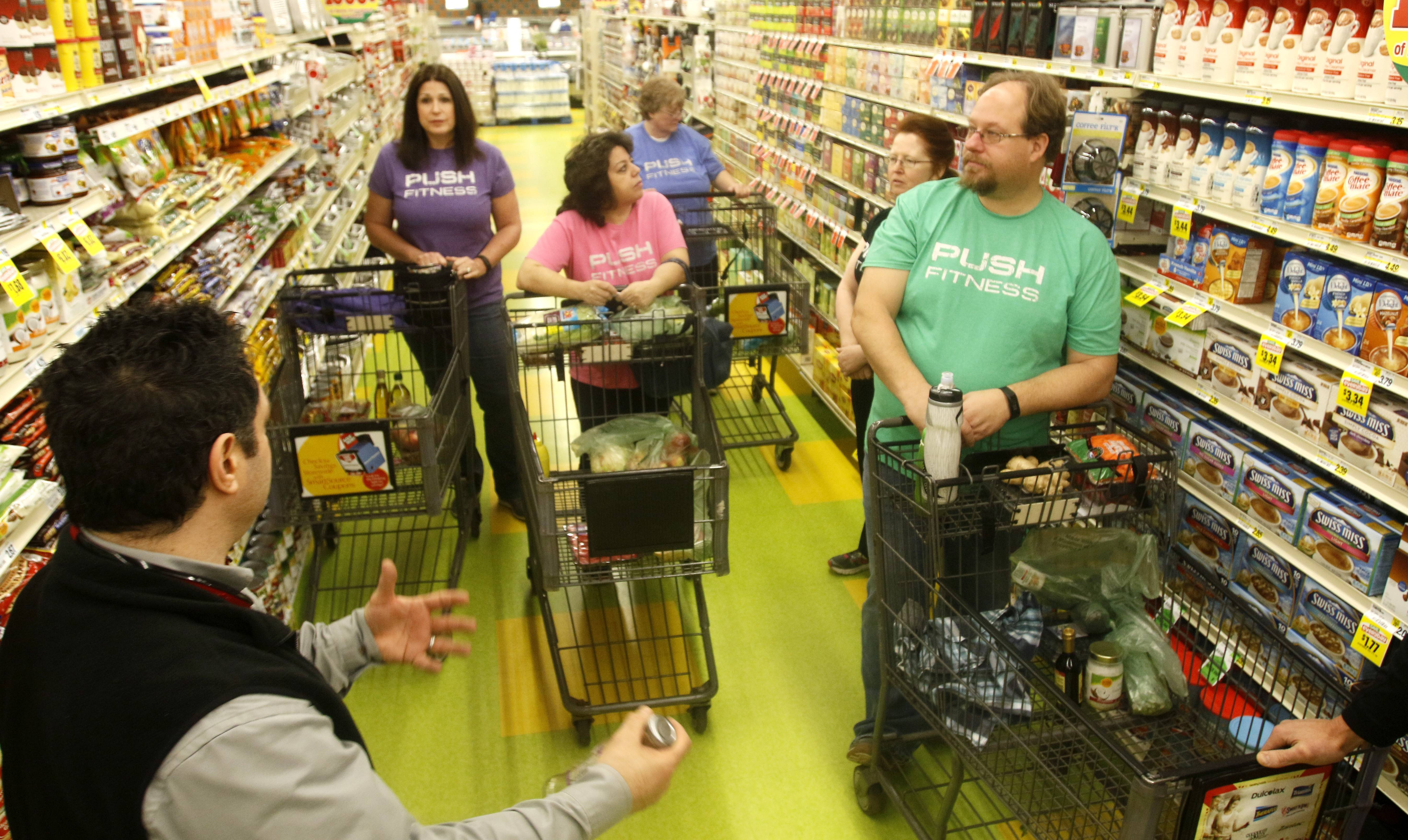 Frank Greco of Valli Produce in Glendale Heights teaches Fittest Loser contestants how to shop for healthier food.