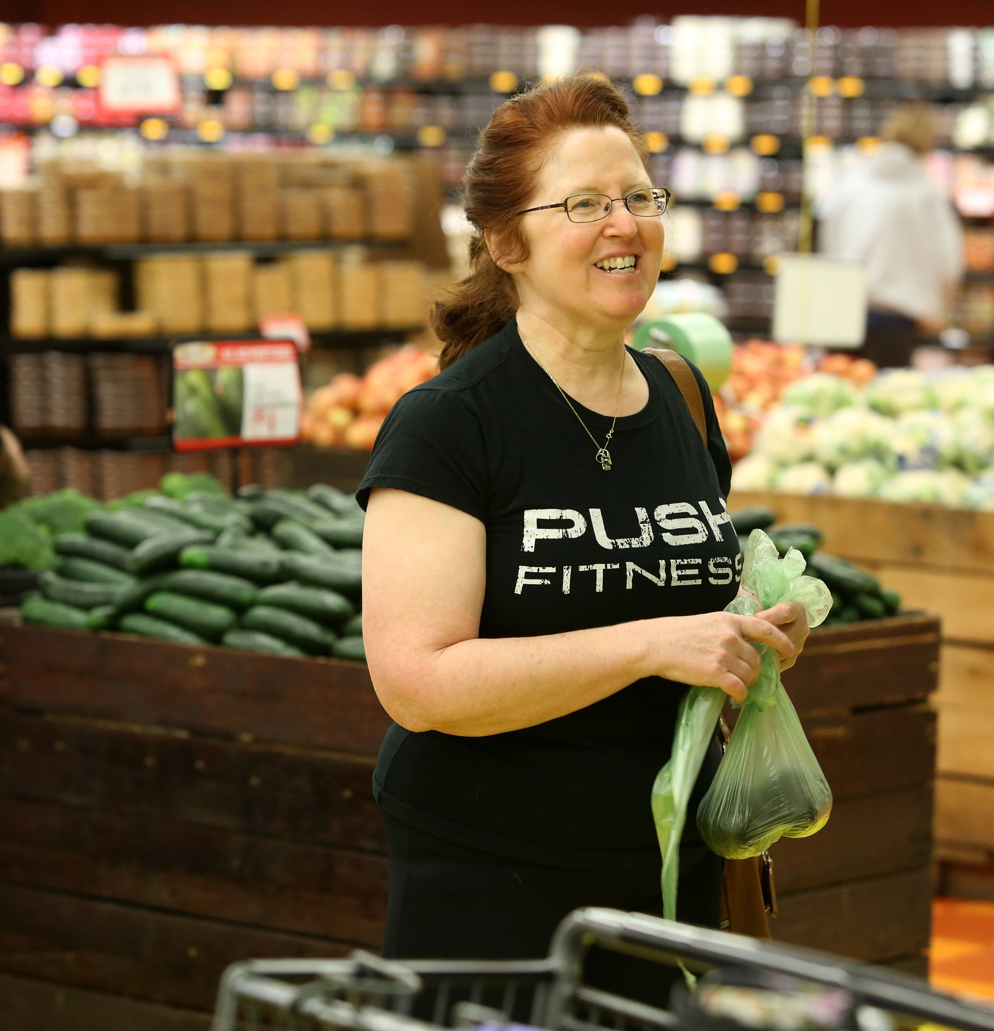 Annie Overboe gets tips on shopping for healthier food at Valli Produce in Glendale Heights.