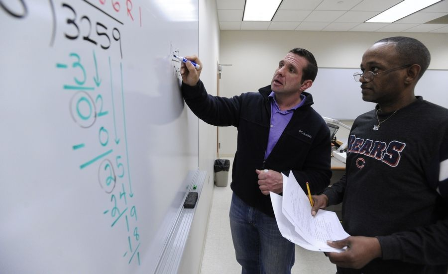 Bill Clark, an associate professor at Harper College in Palatine, teaches a developmental math class for students like Kevin Mack of Rolling Meadows.