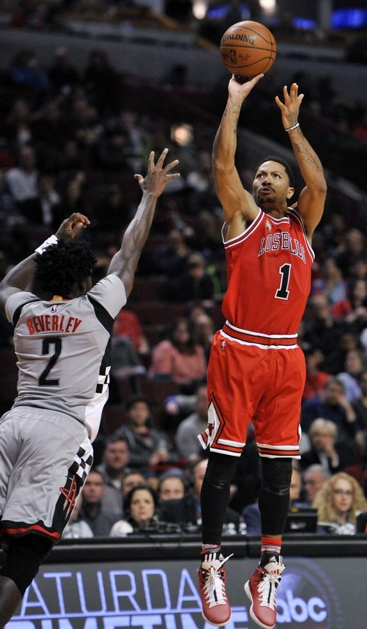 b461abb3791 Chicago Bulls  Derrick Rose goes up for a shot against Houston Rockets   Patrick Beverley