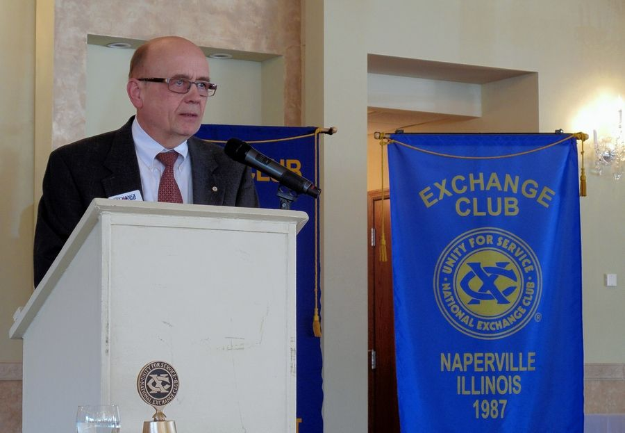 Dan DeBoo, president of the Exchange Club of Naperville, announces the club donated $600,000 raised at Ribfest 2015 to community organizations that help prevent child abuse and domestic violence.