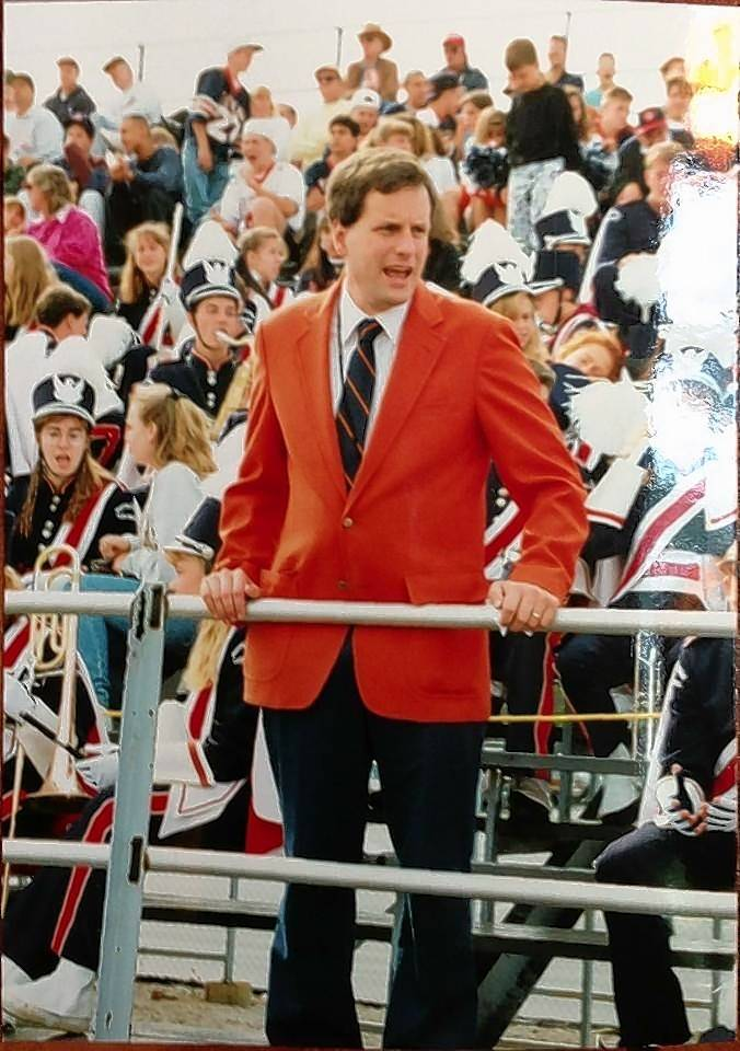 Ed Jacobi in 1985 in his first year as the Buffalo Grove High School band director is with members of the marching band at a home football game.