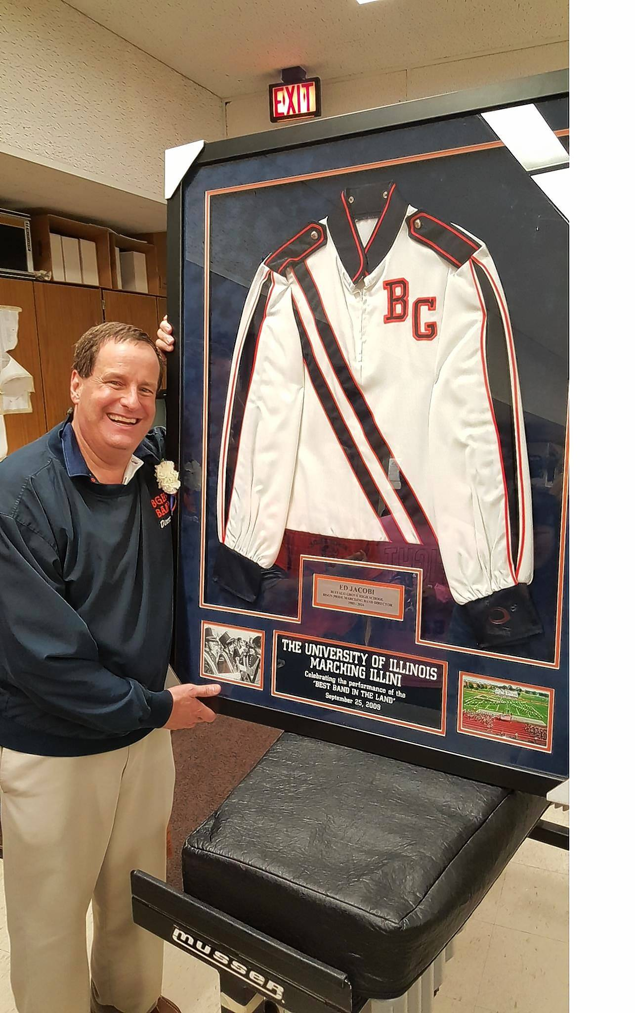 In recognition of his 31 years as director of the Buffalo Grove High School marching band and his ties to University of Illinois' Marching Illini, Ed Jacobi was honored by band members and parents at his last home football game this past fall.