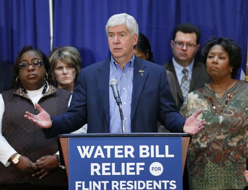 FILE - In this Feb. 26, 2016 file photo, Gov. Rick Snyder speaks after attending a Flint Water Interagency Coordinating Committee meeting in Flint, Mich. A lawsuit stemming from Flint's lead-contaminated water was filed Monday, March 7, 2016 on behalf of the city's residents against Gov. Snyder as well as other current and former government officials and corporations. The federal lawsuit, which is seeking class-action status, alleges that tens of thousands of residents have suffered physical and economic injuries and damages.