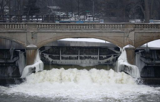 FILE - In this Jan. 21, 2016 file photo, water from the Flint River flows through the Hamilton Dam near downtown Flint, Mich. The state of Michigan restricted Flint from switching water sources last April unless it got approval from Gov. Rick Snyder's administration under the terms of a $7 million loan needed to help transition the city from state management, according to a document released Wednesday, March 2, 2016.