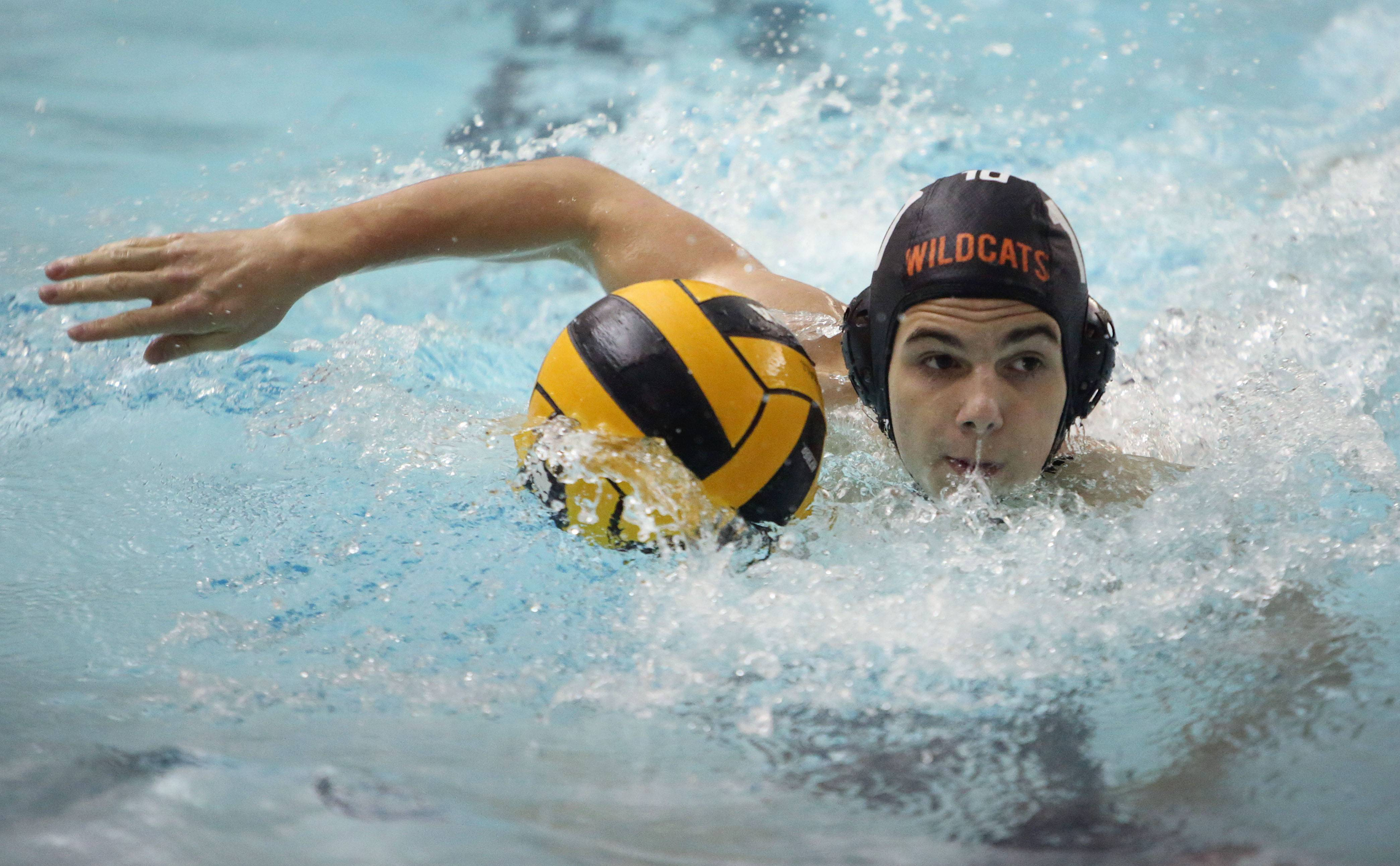Libertyville's Carl Michelotti drives down the pool during the Wildcats' nonconference boys water polo against Deerfield on Tuesday at Libertyville High School.
