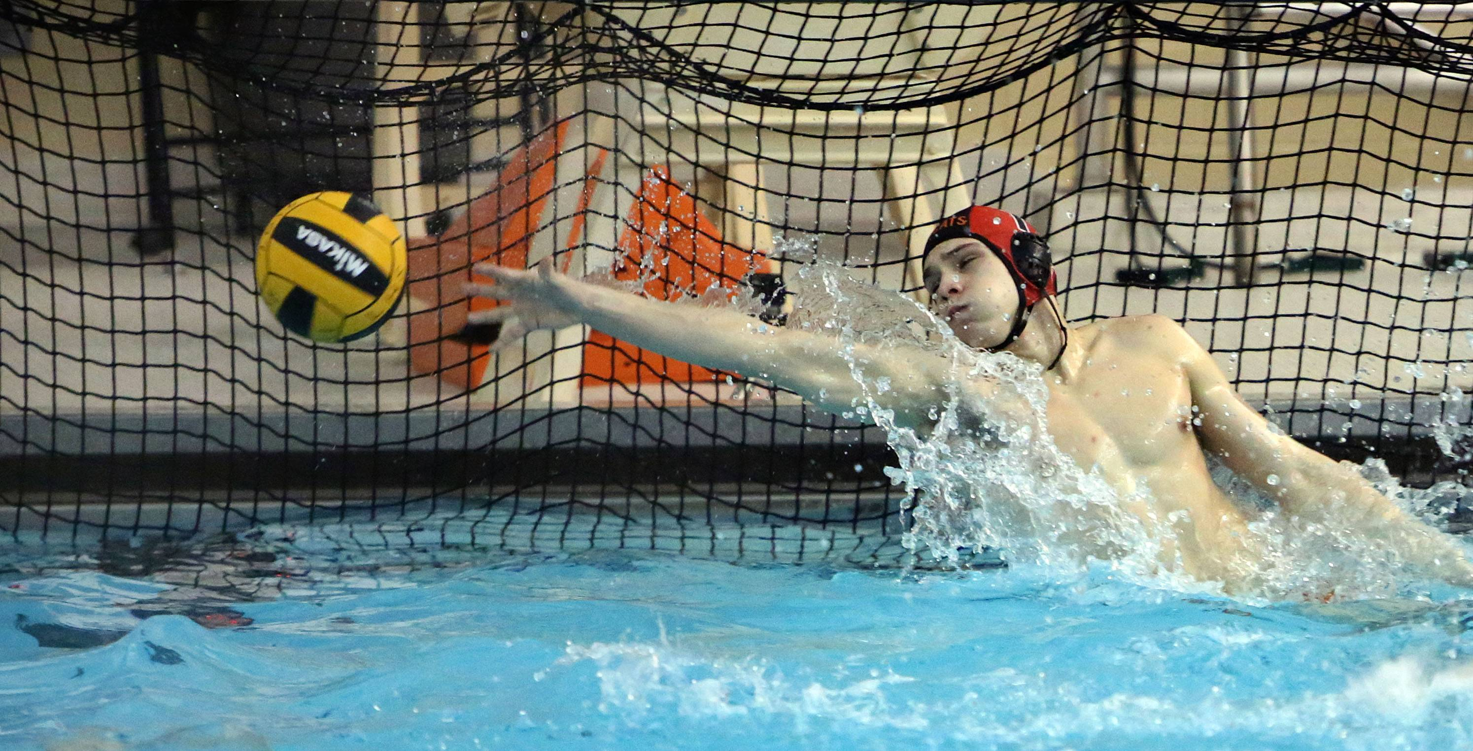 Libertyville's Andrew Fink makes a save against Deerfield on Tuesday at Libertyville High School.