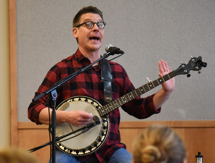 Musician Jim Gill of Oak Park performs a family concert Wednesday at the Ela Area Public Library in Lake Zurich.