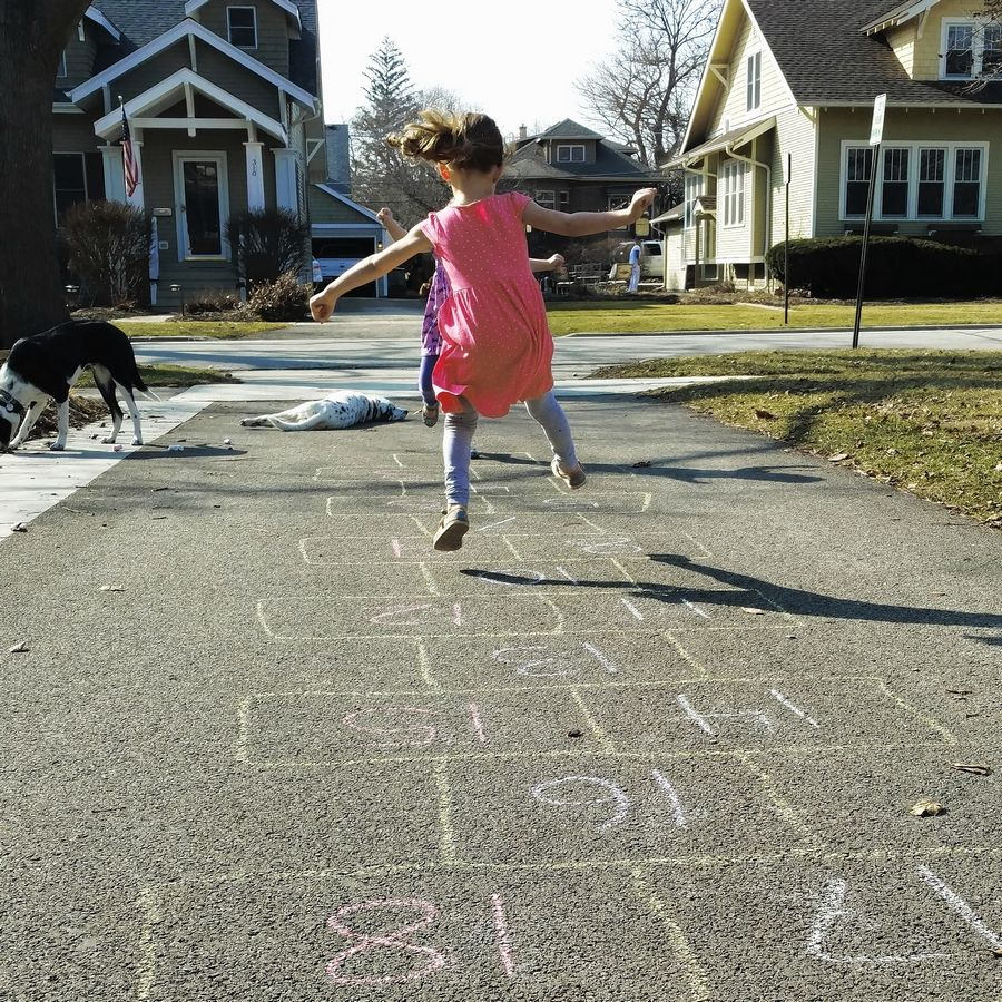 Don't we all feel this way with the warm weather this week? Reader Erin Kalaway of Arlington Heights shared this frameworthy photo she snapped of 3-year-old daughter Lia, airborne as she was playing hopscotch outside.