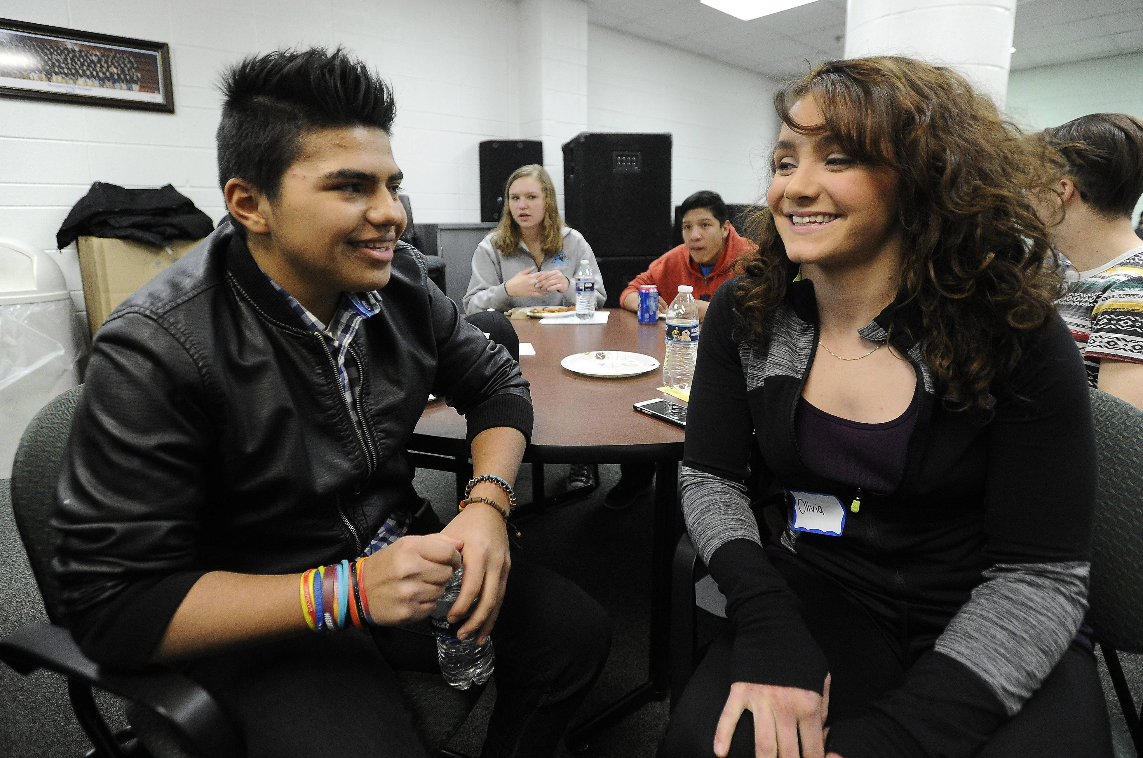 Prospect High School AP Spanish students have pizza with their pen pals who attend the Newcomer Center with a student body of about 36 students. Prospect senior Olivia Sullo, 18, talks with her pen pal David Sarmiento.