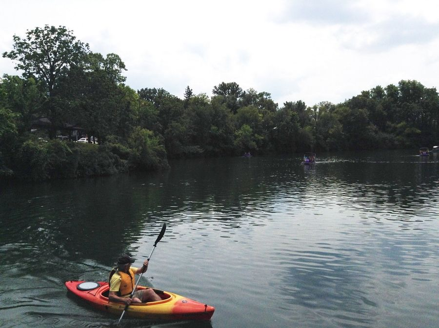 Kayaks and paddleboats dotted the Naperville quarry just hours after fire department divers tried to rescue the people in a car that left the road and plunged into the water.