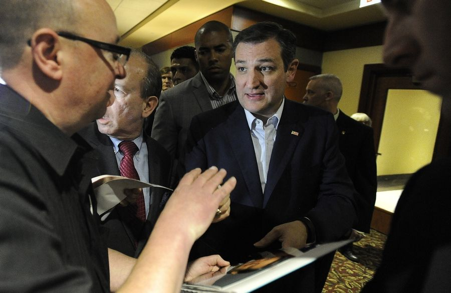 Ted Cruz signs an autograph for a fan at the Meadows Club in Rolling Meadows on Friday.