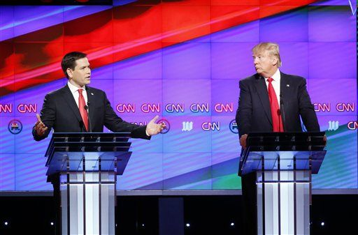 Republican presidential candidate, Sen. Marco Rubio, R-Fla., left,  answers a question, as Republican presidential candidate, businessman Donald Trump listens, during the Republican presidential debate sponsored by CNN, Salem Media Group and the Washington Times at the University of Miami,  Thursday, March 10, 2016, in Coral Gables, Fla.