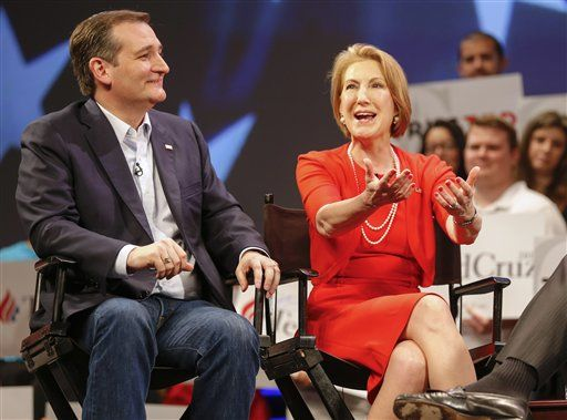 Carly Fiorina gestures to Republican presidential candidate, Sen. Ted Cruz, R-Texas, while taping an interview with Sean Hannity during a campaign stop in Orlando, Fla., Friday, March 11, 2016.