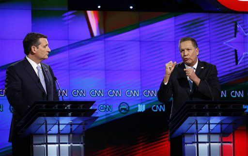 Republican presidential candidate, Ohio Gov. John Kasich, right,  speaks as Republican presidential candidate, Sen. Ted Cruz, R-Texas, listens, during the Republican presidential debate sponsored by CNN, Salem Media Group and the Washington Times at the University of Miami,  Thursday, March 10, 2016, in Coral Gables, Fla.