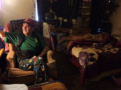 "In this Jan. 29, 2016 photo, Steven Gibbs, 61, sits in the motel room he shares with his wife, Debbie, and their daughter and son-in-law in Murfreesboro, Tenn. ""Half the time I'm scared to go outside the door,"" says Gibbs, 61, a former construction worker who has been jailed twice since late 2013 after he couldn't pay hundreds of dollars in probation fees for driving on a suspended license. Despite a court order barring the county and a private probation company from jailing him again, those fears linger."