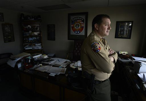 "In this Jan. 27, 2016 photo, Rutherford County Sheriff Robert F. Arnold stands in his office in Murfreesboro, Tenn. Probation is supposed to substitute for jail or prison, requiring offenders to report regularly and maintain good behavior. But in this fast-growing county outside Nashville and more than a dozen states, probation for misdemeanors is a profit-making - and increasingly contentious - venture. ""It's not supposed to be about the money,"" says Arnold, noting that he chooses words carefully in a county sued for its use of for-profit probation."