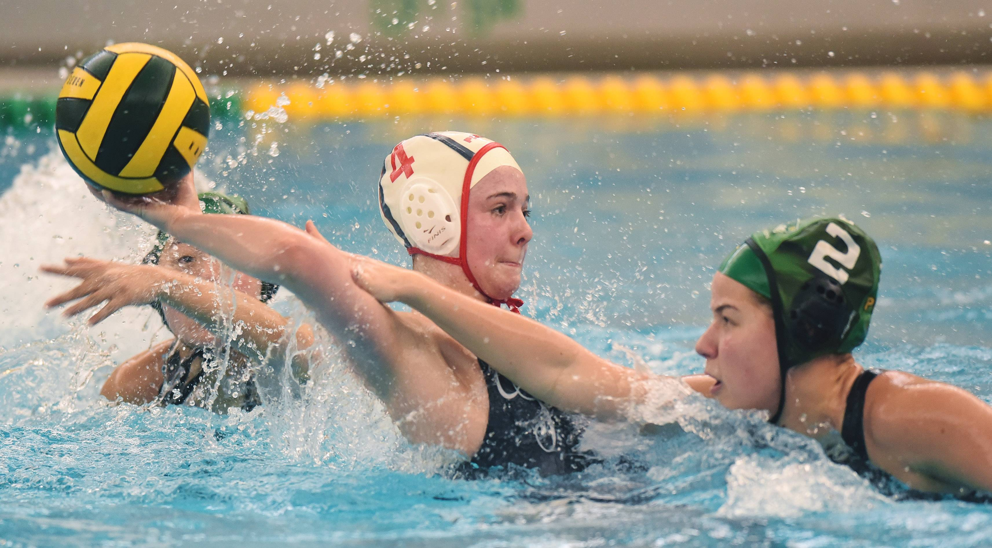 Stevenson's Tanya Shklier, right, defends a pass by Palatine's Mathilde Mogensen during Saturday's girls water polo quad at Stevenson High School in Lincolnshire.