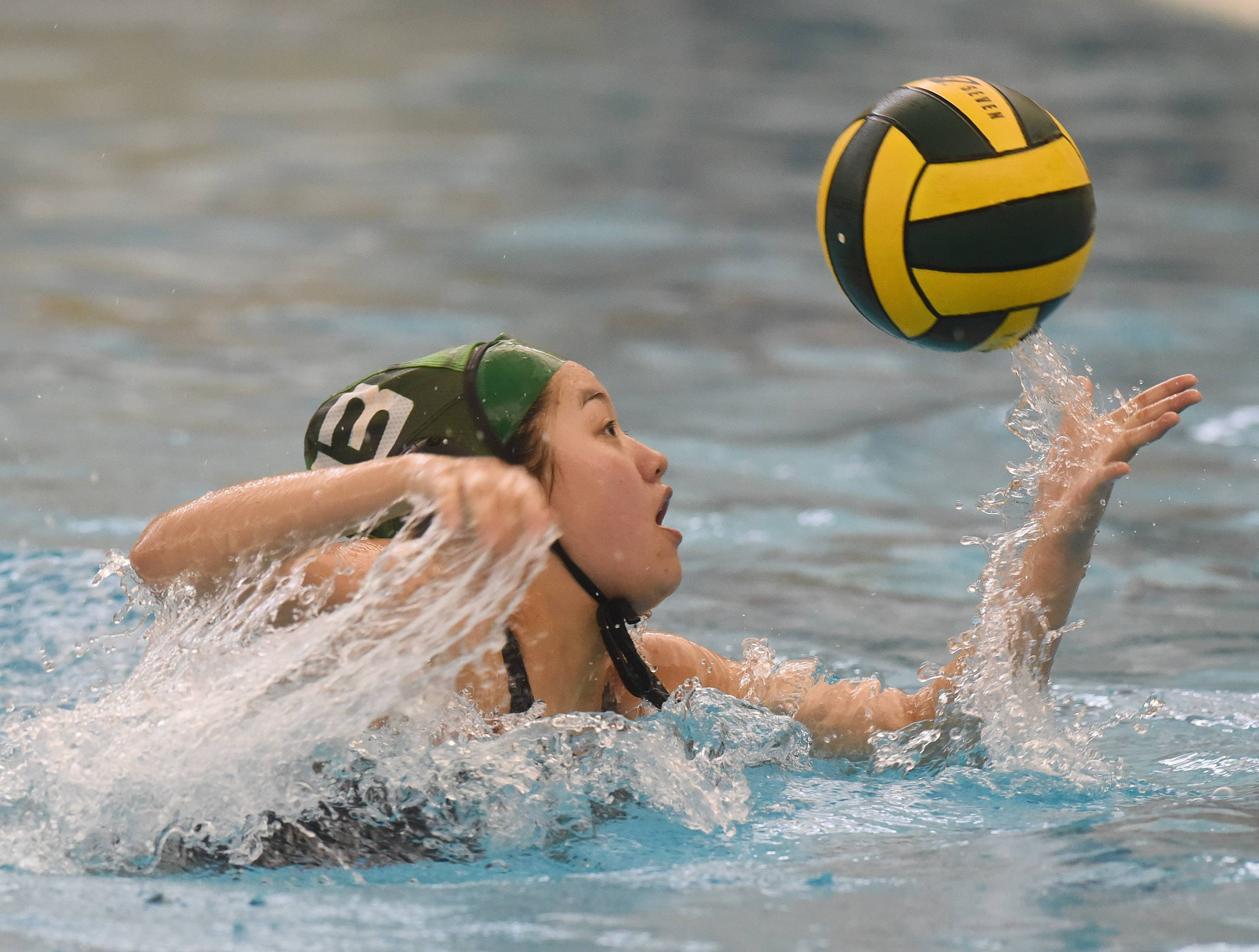 Stevenson's Eileen Hoang gains control of a pass against Palatine during Saturday's quad at Stevenson.