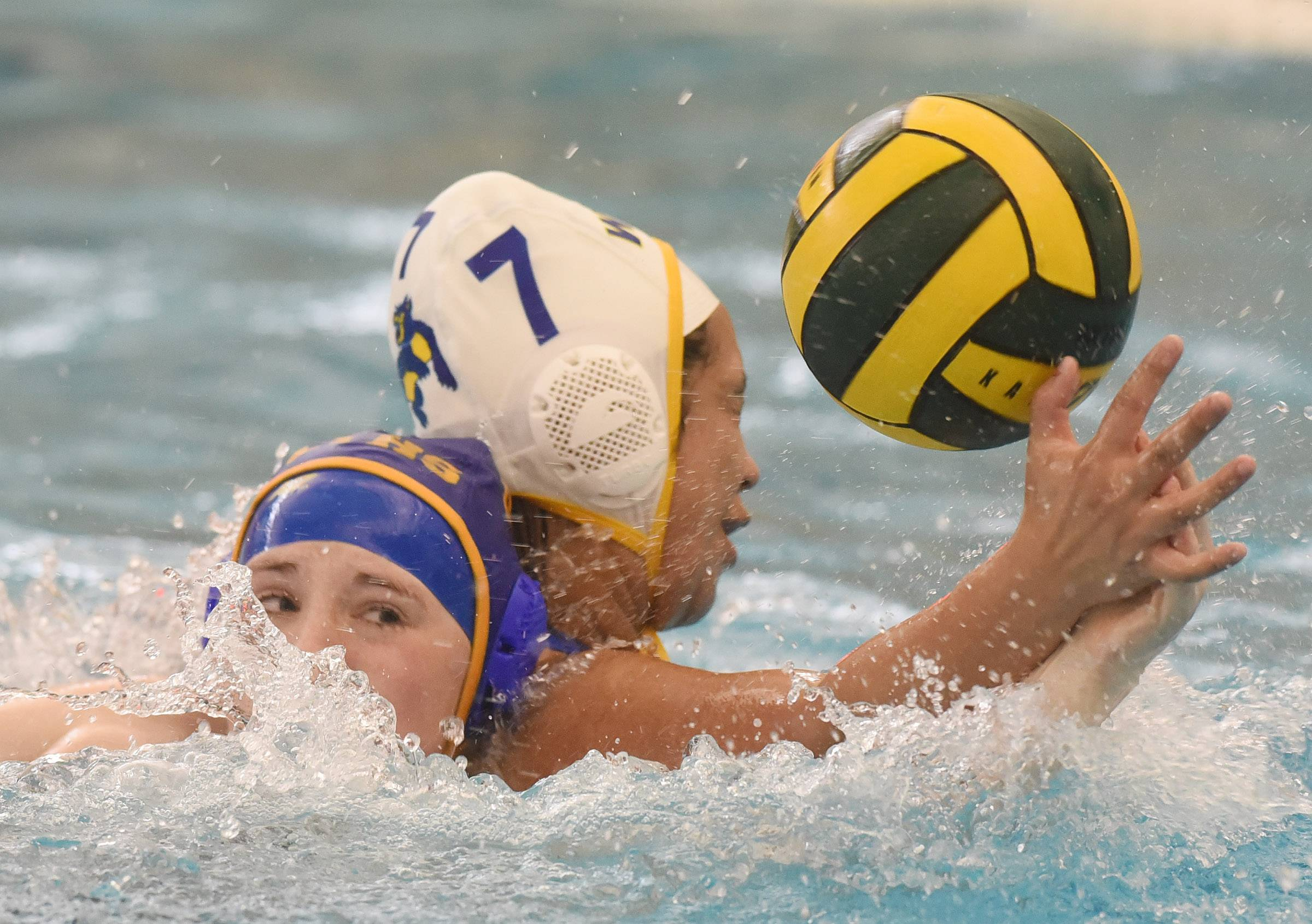 Wheeling's Argelina Diaz, right, breaks up a Lyons' pass in front of the goal during Saturday's quad at Stevenson.
