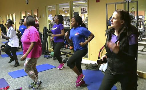 In this Feb. 1, 2016 still photo from video, Gibbs Saunders, right, managing director of the nonprofit Healthworks Community Fitness, exercises with clients at their gym in the Boston neighborhood of Dorchester. Doctors treating chronic health problems increasingly are prescribing exercise instead of medicines for their patients. At one health center in Boston, primary care physicians, internists and psychologists prescribe access to a gym for $10 a month.