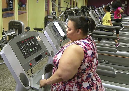 In this Feb. 1, 2016 still photo from video, Stephanie Dennis works on a treadmill at the nonprofit gym run by Healthworks Community Fitness in Boston's Dorchester neighborhood. Doctors treating chronic health problems increasingly are prescribing exercise instead of medicines for their patients. At one health center in Boston, primary care physicians, internists and psychologists prescribe access to a gym for $10 a month.