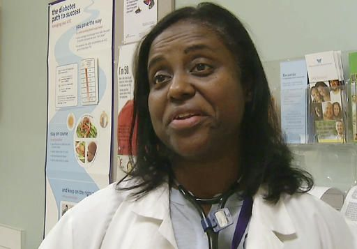 In this Feb. 17, 2016 still photo from video, Dr. Michelle Johnson discusses prescriptions for exercise that she issues to patients at Whittier Street Health Center in Boston's Roxbury neighborhood. Doctors treating chronic health problems increasingly are prescribing exercise instead of medicines for their patients. At one health center in Boston, primary care physicians, internists and psychologists prescribe access to a gym for $10 a month.