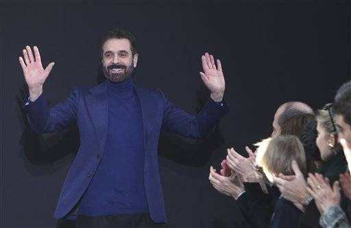 FILE -- In this file photo taken on March 3 2013, Italian fashion designer Ennio Capasa reacts after the presentation of  Costume National's Ready to Wear's Fall-Winter 2013-2014 fashion collection, presented in Paris. Costume National founder and creative director Ennio Capasa has stepped down following the takeover of the brand by its Japanese partner, Sequedge.