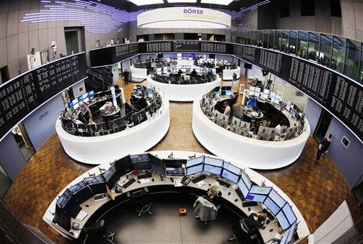 Brokers work in the trading room of the stock market in Frankfurt, Germany, Wednesday, March 16, 2016. Deutsche Boerse and London stock exchange plan to merge.