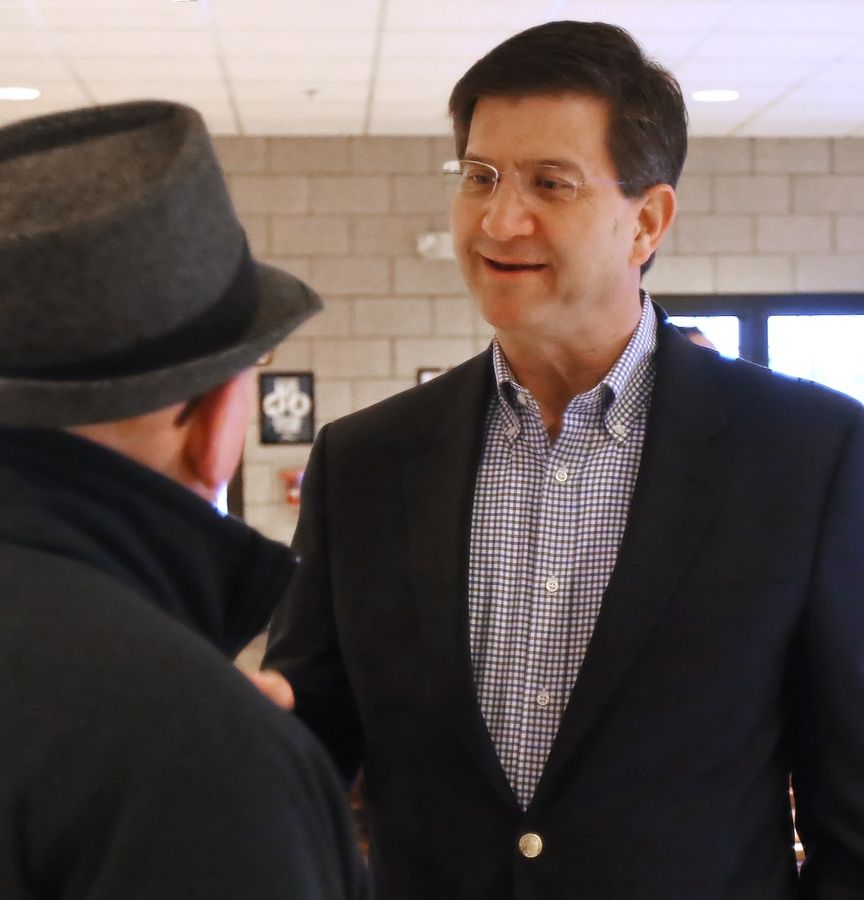 Democratic Party congressional nominee Brad Schneider thanks voters at a Deerfield train station on Wednesday morning.