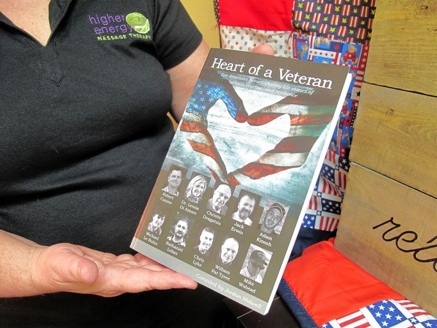 """Heart of a Veteran,"" a book compiling the stories of 10 veterans who write about their service as a part of their path to healing, is now for sale. Naperville massage therapist Jordan Holwell compiled the stories."