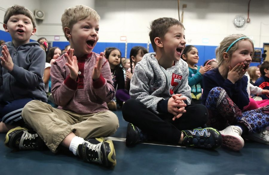 "Children laugh as bubbleologist Geoff Akins-Hannah makes bubble creations during ""Bubble Wonders"" at Dwight D. Eisenhower Elementary School in Prospect Heights. Akins created a bubble caterpillar, a smoking bubble, and captured a kid in a bubble at the show as he entertained students in early childhood, kindergarten and first grade."