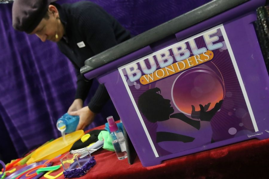 "Bubbleologist Geoff Akins-Hannah prepares for his ""Bubble Wonders"" show at Dwight D. Eisenhower Elementary School in Prospect Heights. Akins-Hannah created a bubble caterpillar, a smoking bubble, and captured a kid in a bubble at the show as he entertained students in early childhood, kindergarten and first grade."