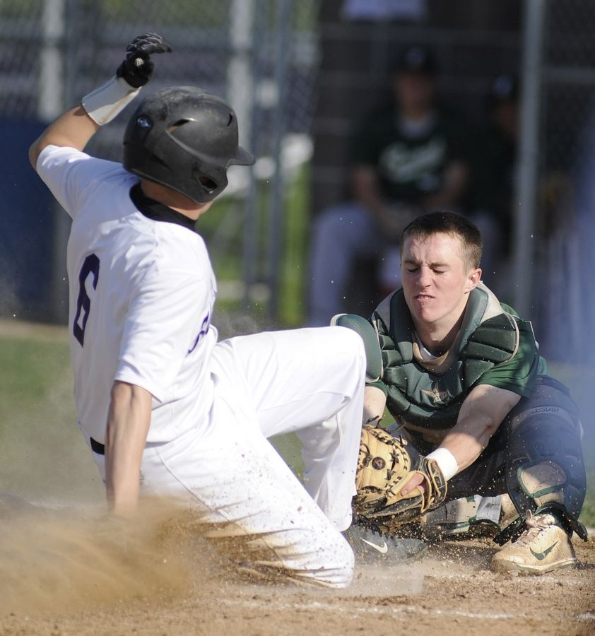 Grayslake Central senior catcher Sam Nozicka, here bracing for a play at the plate with Hampshire's Dillon Kuhn last spring, is headed for a future at Memphis.