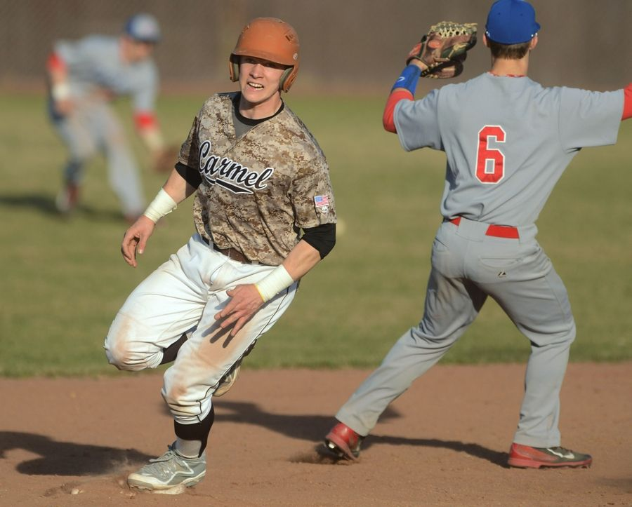Cooper Johnson, here rounding second base against Lakes last season, is hoping he can help Carmel Catholic to a bounce-back season.