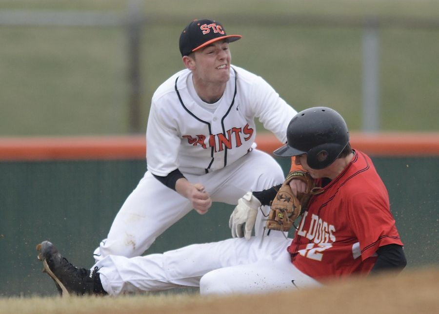 St. Charles East's James Dale tags out Batavia's Andrew Costigan at third base last season.