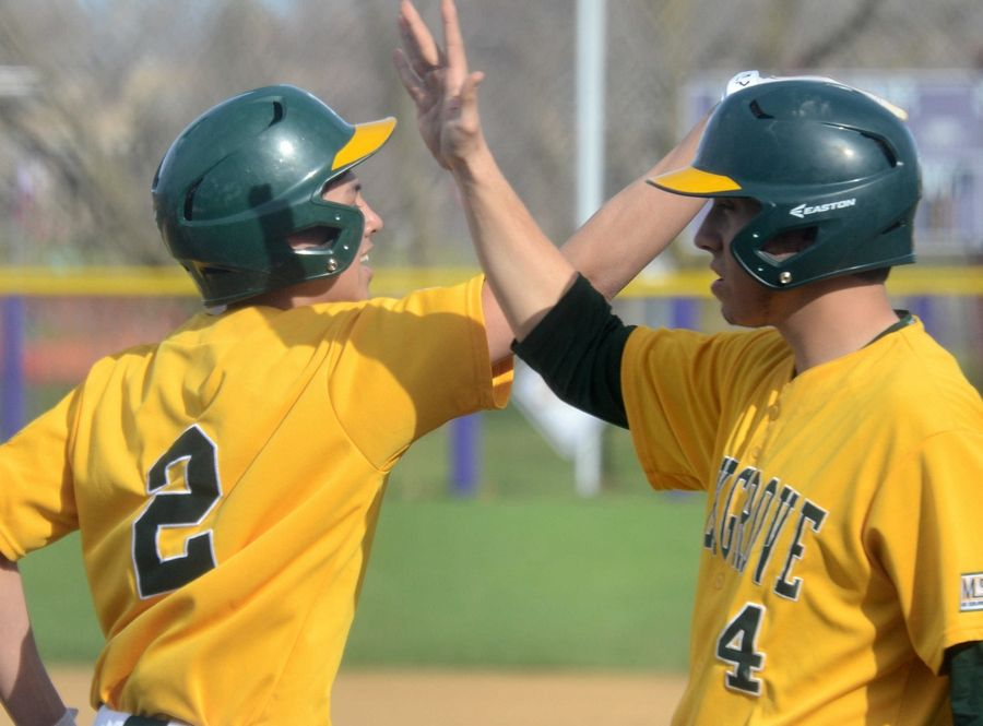 Elk Grove's Christian Camacho, left, high-fives Chuck Fleming last season. Both players return for the MSL champs this spring.