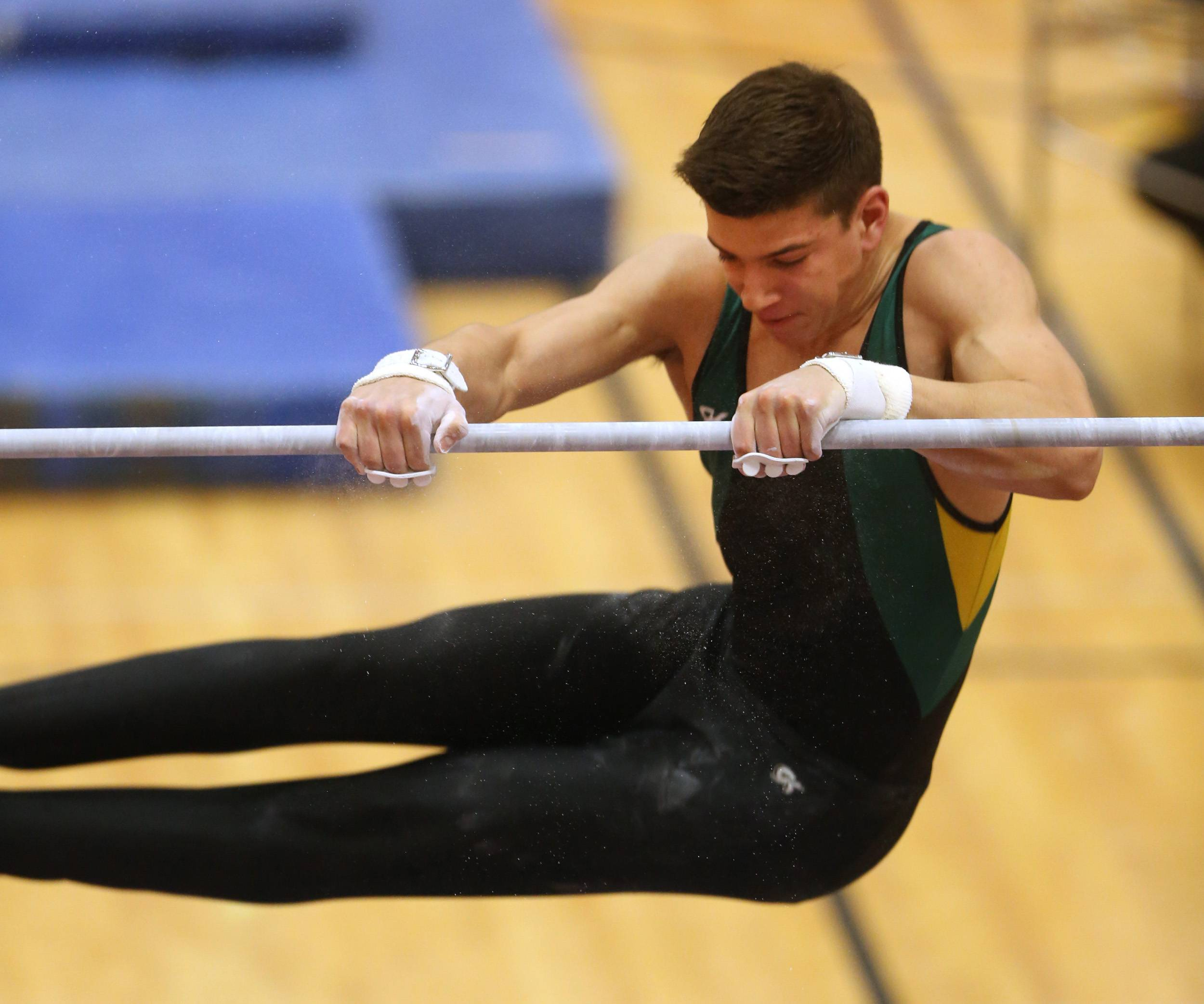 Matt Krames of Stevenson performs his horizontal bar routine during last year's state finals at Hinsdale Central.